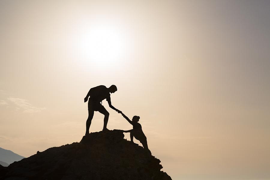 Berggipfel bezwingen und Ziele gemeinsam erreichen.